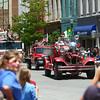 7-5-14<br /> Haynes Apperson Parade<br /> Parade-goers watch as Kokomo's Fire Department arrives at the courthouse square during the Haynes Apperson parade.<br /> Kelly Lafferty | Kokomo Tribune