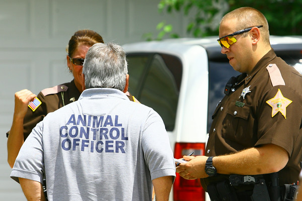 7-2-14   --- Animal Control Officer Billy Bryant working in Kokomo and Howard County. Billy working with Howard County deputies on a situation of animal neglect.  --<br />   Tim Bath | Kokomo Tribune