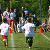 7-5-14<br /> Haynes Apperson Sports<br /> Kids run to the finish line as family and friends watch during the Haynes Apperson Kids Track Meet on Saturday morning.<br /> Kelly Lafferty | Kokomo Tribune