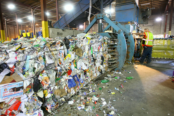 7-3-14   --- Kokomo Recycle at 1701 North Market Street current operations with expansion coming so they can accomadate City of Kokomo curbside program. Jerry Biehle operates a baler that is packing recyclables to be shipped to a different location. --<br />   Tim Bath   Kokomo Tribune