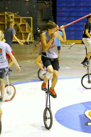 7-3-14   --- Unicycling act in the Peru Circus is the Gibson family. All 4 have been riding unicycles since they were little. Emily, Caleb, Abigial and Gideon. --   Tim Bath | Kokomo Tribune