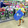 7-25-14 <br /> Grand Opening of Five Below in the Markland Plaza. Adam Turner, 9, with the boogie board he found for his beach vacation.<br /> Tim Bath | Kokomo Tribune