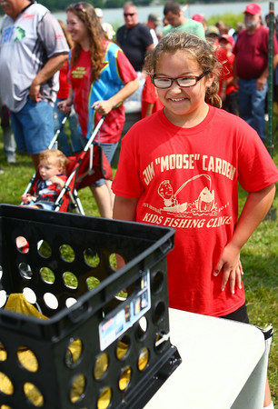 7-26-14<br /> Kids Fishing Clinic<br /> Lauren Danenfelser, 9, grins as she watches her fish get weighed during tournament day of the Kids Fishing Clinic.<br /> Kelly Lafferty | Kokomo Tribune