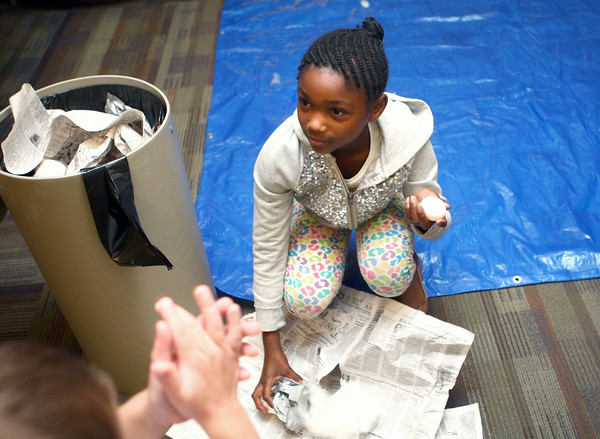 7-16-14<br /> Egg Drop at Howard County Public Library<br /> 9-year-old Follesha Bogan holds up her egg, still in perfect condition after being dropped from two floors up at the Howard County Public Library.<br /> Kelly Lafferty | Kokomo Tribune