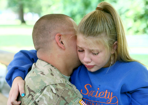 7-17-14 Surprise soldier return Tears roll down 13-year-old Maiah Lee's face as she hugs her dad David Lee. Lee and his brother Jake surprised their kids at Highland Park after being gone for a year while they served in Afghanistan. Kelly Lafferty | Kokomo Tribune