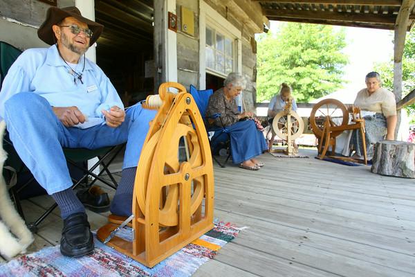 7-8-14<br /> Howard County Fair. Cleo Metcalf spinning wool in Pioneer Village.<br /> Tim Bath | Kokomo Tribune