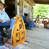 7-8-14<br /> Howard County Fair. Cleo Metcalf spinning wool in Pioneer Village.<br /> Tim Bath | Kokomo Tribune