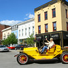 7-3-14   --- Steve Wooldridge drove his 1914 Apperson automobile from Guyer and Boulevard(Pumpkinvine Pike) to the Haynes Apperson Festival through downtown in a vintage car parade on Thursday evening to kick off the festival.  --<br />   Tim Bath | Kokomo Tribune