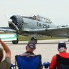 7-26-14<br /> Kokomo Air Show<br /> The crowd watches and applauds as a pilot taxis into the Kokomo Airport after performing above it.<br /> Kelly Lafferty | Kokomo Tribune