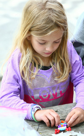 7-15-14<br /> KRPD Recreation Adventure Program<br /> 7-year-old Braylee Young strings beads together to shape a dog during KRPD's Recreation Adventure Program in Highland Park.<br /> Kelly Lafferty | Kokomo Tribune