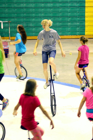 7-3-14   --- Unicycling act in the Peru Circus is the Gibson family. All 4 have been riding unicycles since they were little. Emily, Caleb, Abigial and Gideon. --<br />   Tim Bath | Kokomo Tribune