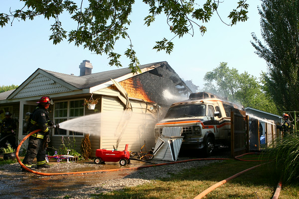 7-22-14<br /> Firefighters work to contain the fire at 1201 Peace Pipe Drive in Indian Heights on Tuesday afternoon.<br /> Kelly Lafferty | Kokomo Tribune
