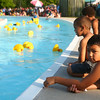 7-17-14<br /> Duck Derby<br /> Brandon Bennett watches the Papa Duck Derby with his three siblings at Kokomo Beach Thursday evening.<br /> Kelly Lafferty | Kokomo Tribune