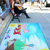 6-6-14   --- Chalk the Block in conjunction with First Friday was a fundraiser for Fair Queen Mollee Mygrant.  Chris Lawrence playing the guitar sitting next to the art on Main Street. --<br />   Tim Bath | Kokomo Tribune