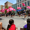 7-5-14<br /> Haynes Apperson Parade<br /> Parade-goers watch as Kokomo High School's colorguard performs its way down Main Street in the Haynes Apperson parade.<br /> Kelly Lafferty | Kokomo Tribune