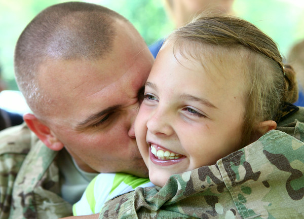 7-17-14 Surprise soldier return 8-year-old Annah Lee is all smiles while her dad David Lee gives her a kiss. They hadn't seen each other for almost a year while Lee was serving in Afghanistan. Kelly Lafferty | Kokomo Tribune