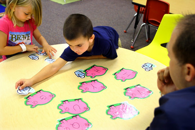 7-9-14  Lauren Nichols and Ricky Patton work with teacher Shane Metlock on letters using pictures during Early Head Start at Darrough Chapel. Tim Bath | Kokomo Tribune