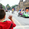 7-19-14<br /> Circus Parade<br /> 4-year-old Jon Mason waves to the clowns in Peru's circus parade.<br /> Kelly Lafferty | Kokomo Tribune