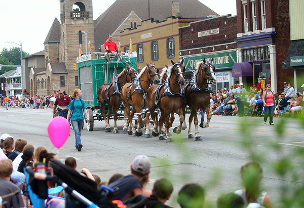 7-19-14<br /> Circus Parade<br /> The circus parade passes through downtown Peru on Saturday morning.<br /> Kelly Lafferty | Kokomo Tribune