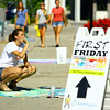 6-6-14   --- Chalk the Block in conjunction with First Friday was a fundraiser for Fair Queen Mollee Mygrant. Hadley Orr taking a break while working on her Mulberry Street art. --<br />   Tim Bath | Kokomo Tribune