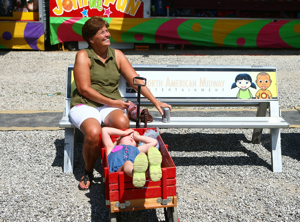 7-9-14<br /> Fair--Wednesday<br /> Traci Munsey and her 3-year-old granddaughter Bella Bailey watch as a ride spins during the Howard County 4H Fair.<br /> Kelly Lafferty | Kokomo Tribune
