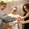 7-16-14<br /> Egg Drop at Howard County Public Library<br /> Carter Condo, 12, and Matthew Edison, 12, get help from Howard County Public Library reference assistant, Beth Stone, as they make their contraption for the egg drop.<br /> Kelly Lafferty | Kokomo Tribune