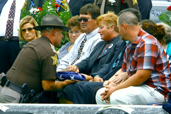 7-7-14   --- Funeral for Tipton County Deputy Jacob Calvin held at Carroll High School with burial at Maple Lawn Cemetery. The flag draped over Calvin's casket is handed to his mother. --<br />   Tim Bath | Kokomo Tribune