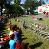 7-9-14<br /> Fair--Wednesday<br /> The audience watches as four pigs race around the track during the Howard County 4H Fair's pig races on Wednesday afternoon.<br /> Kelly Lafferty | Kokomo Tribune
