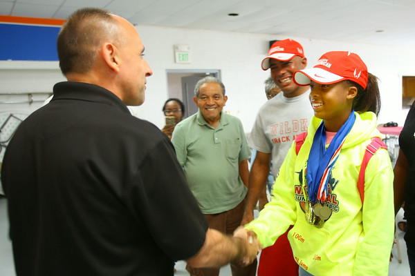 7-30-14<br /> A party was held in honor of Tionna Brown a three event winner in the USA Track & Field Junior Olympic national meet. She shakes hands with Mayor Greg Goodnight.<br /> Tim Bath | Kokomo Tribune