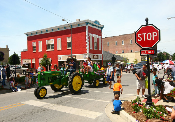 7-5-14<br /> Haynes Apperson Parade<br /> Pregnancy Resource Center makes its way down Main Street with a tractor during the Haynes Apperson parade.<br /> Kelly Lafferty | Kokomo Tribune