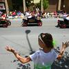 7-5-14<br /> Haynes Apperson Parade<br /> 8-year-old Maddy Cook waves to the Kokomo Shrine Club as they pass by during the Haynes Apperson parade.<br /> Kelly Lafferty | Kokomo Tribune