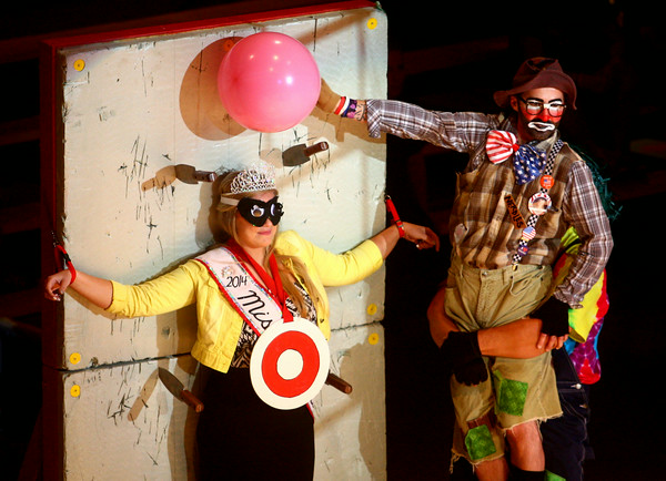 7-12-14<br /> Peru Circus<br /> The Peru Amateur Circus clowns perform an act with Miss Circus City Festival, Madison Hair, during Saturday afternoon's performance.<br /> Kelly Lafferty   Kokomo Tribune