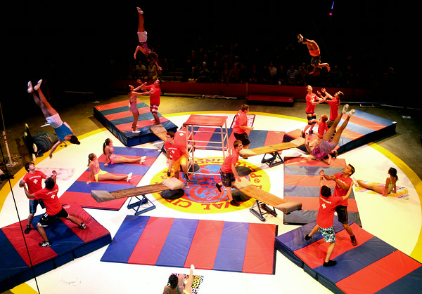 7-12-14<br /> Peru Circus<br /> Teeterboard performers flip through the air in center ring during the Peru Amateur Circus.<br /> Kelly Lafferty | Kokomo Tribune