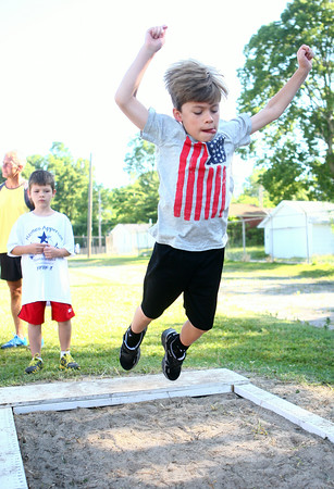 7-5-14<br /> Haynes Apperson Sports<br /> R.J. Jones, 7, jumps into the sand during the Haynes Apperson Kids Track Meet long jump.<br /> Kelly Lafferty | Kokomo Tribune
