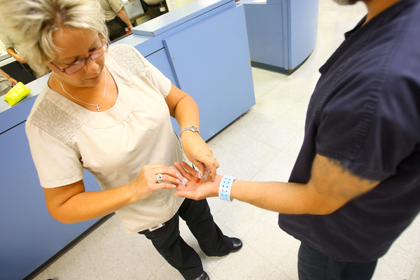 7-9-14 <br /> Nurse Kristie Shirey hands meds to an inmate who has mental health problems at the Howard County Criminal Justic Center.<br /> Tim Bath | Kokomo Tribune