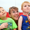 7-26-14<br /> Kokomo Air Show<br /> Dana Miller points to a plane performing tricks in the sky during the Kokomo Air Show as brothers 4-year-old Grayson Posey, left, and 3-year-old Landon Miller watch.<br /> Kelly Lafferty | Kokomo Tribune