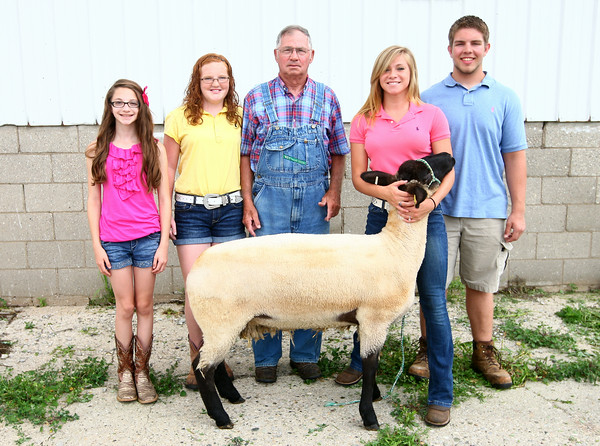6-19-14<br /> Joe Pohlman (center) with his grandkids who plan to show sheep at the fair, from left: Olivia Foland, Madison Ingram, Amber Miller, and Nick Ingram.<br /> Kelly Lafferty | Kokomo Tribune