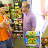 6-30-14   --- Seth Graber looking for fireworks at Best Price Fireworks at Markland and Plate Streets. Joe Wampler, the owner, talks about options. --<br />   Tim Bath | Kokomo Tribune