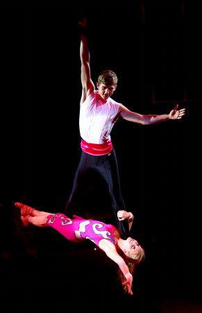 7-12-14<br /> Peru Circus<br /> Connor Quin and Ashley Collins perform mid-air on straps, one of the acts in the Peru Amateur Circus.<br /> Kelly Lafferty | Kokomo Tribune