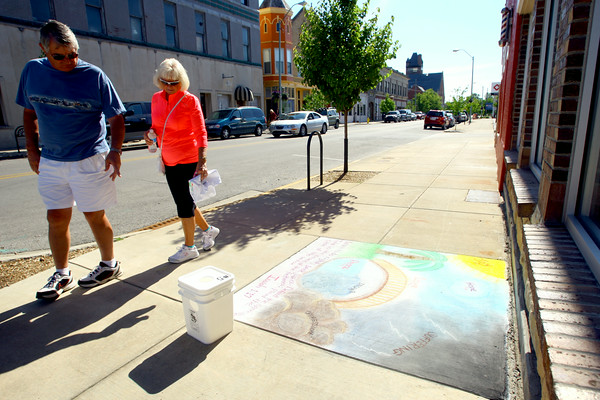 6-6-14   --- Chalk the Block in conjunction with First Friday was a fundraiser for Fair Queen Mollee Mygrant.  Gary and Cindi Roberts take a look at the art along Mulberry Street. --<br />   Tim Bath | Kokomo Tribune