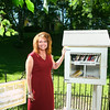 7-10-14<br /> Micro library<br /> Melanie Waggoner stands next to her Little Free Library on Sycamore Street.<br /> Kelly Lafferty | Kokomo Tribune
