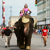 7-19-14<br /> Circus Parade<br /> Two elephants bring up the rear of the circus parade in Peru on Saturday.<br /> Kelly Lafferty | Kokomo Tribune