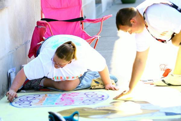 6-6-14   --- Chalk the Block in conjunction with First Friday was a fundraiser for Fair Queen Mollee Mygrant.  Sunny McClurg and Maci McClurg work on their sidewalk art. --<br />   Tim Bath | Kokomo Tribune