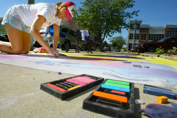 6-6-14   --- Chalk the Block in conjunction with First Friday was a fundraiser for Fair Queen Mollee Mygrant.  Jaelynn Maple working on her art. --<br />   Tim Bath | Kokomo Tribune