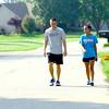 7-31-14<br /> Prairie Acres neighborhood. Kyle Dickover and Elizabeth Boyle who grew up in the neighborhood were out for a jog and walk.<br /> Tim Bath | Kokomo Tribune