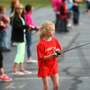 7-15-14<br /> Kids Fishing Clinic casting practice<br /> Shelby Cosat, 8, looks toward her target during the Kids Fishing Clinic casting practice in Kokomo High School's parking lot on Tuesday.<br /> Kelly Lafferty | Kokomo Tribune