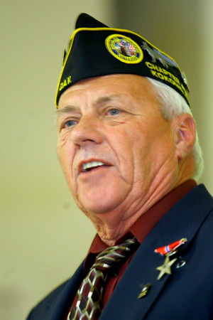 7-1-14   --- Allen Meeks received the bronze star that was presented by Colonel Ross Waltmath at IUK on Tuesday. Meeks then talks about his time in Vietnam. --<br />   Tim Bath | Kokomo Tribune