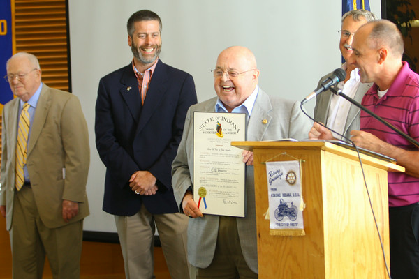 7-1-14   --- E.P. Severns receiving the Sagamore of the Wabash award at the Noon Rotary Club meeting at the Kokomo Country Club. Severns stands with the award with Don Button, Paul Wyman and Mike Karickhoff standing behind him and Mayor Greg Goodnight talking about him.  --<br />   Tim Bath | Kokomo Tribune