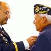 7-1-14   --- Allen Meeks received the bronze star that was presented by Colonel Ross Waltmath at IUK on Tuesday.  --<br />   Tim Bath | Kokomo Tribune