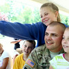 7-17-14<br /> Surprise soldier return<br /> 13-year-old Maiah Lee takes a selfie with her 11-year-old brother Isiah, her dad David, and her 8-year-old sister Annah at Highland Park Thursday afternoon. David Lee and his brother Jake surprised their kids after serving in Afghanistan for almost a year.<br /> Kelly Lafferty | Kokomo Tribune